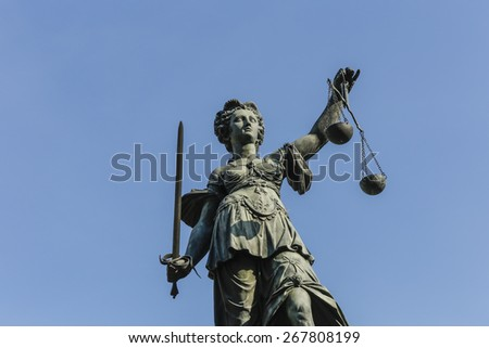 tatue of Lady Justice (Justitia) in Frankfurt, Germany - stock photo