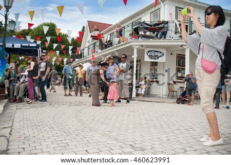 TAURANGA, NEW ZEALAND - APRIL 1;Tourists enjoying Tauranga Historic Village popular tourist destination and host of National Jazz festival.April 1, 2013 in Tauranga New Zealand