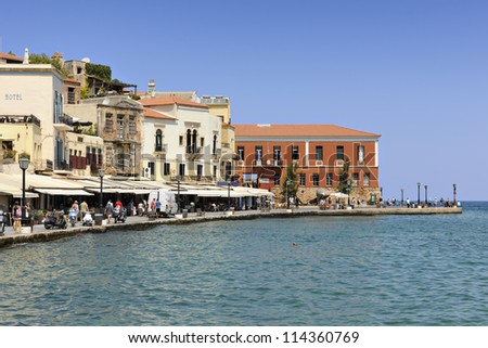 Tavernas and restaurants surrounding the harbour of Chania, Crete, Greece - stock photo