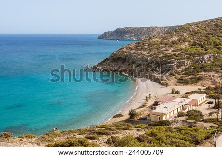 Taverns and hostel at the small beach of Korfos on the east side of the island Gavdos. View to the south, direction Kap Tripiti, the outhernmost point of Europe - stock photo