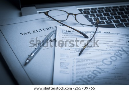 Tax accounting preparation before April 15 - stock photo