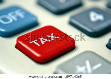 Tax Calculator with Red Button - stock photo