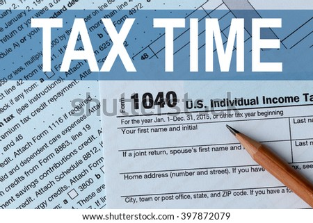 Tax Concept. 1040 Individual Income Tax Return Form for 2015 year with a pencil to fill in, close up - stock photo
