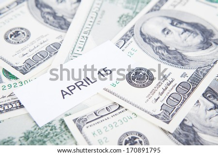 Tax day concept with money and text of april 15 - stock photo
