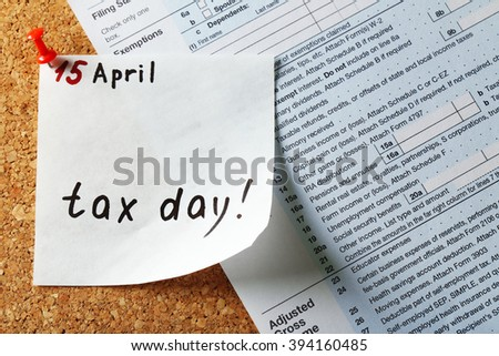 Tax day reminder pinned on the board, close up - stock photo