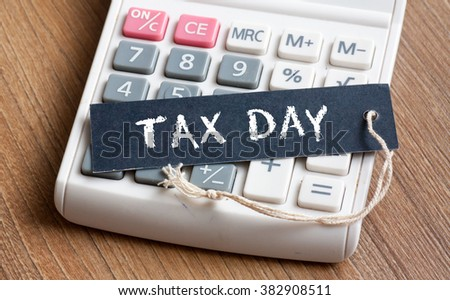 Tax Day words written on label with calculator,Business Concept - stock photo