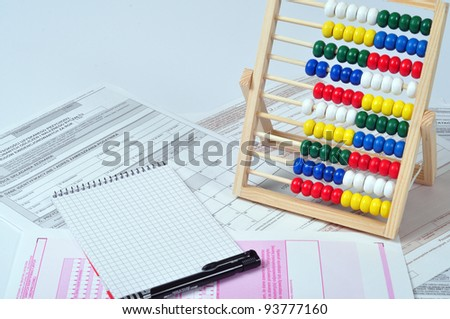 Tax documents and abacus