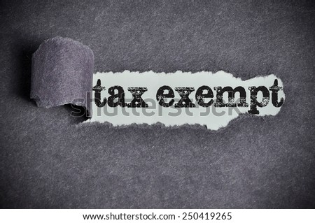 tax exempt word under torn black sugar paper  - stock photo