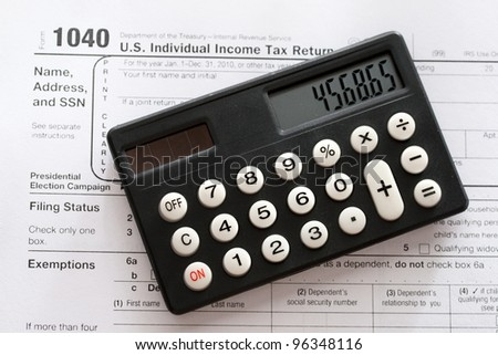 Tax form and calculator - stock photo