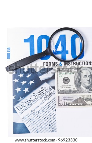 Tax form booklet 1040 with magnifying glass and money on white background - stock photo