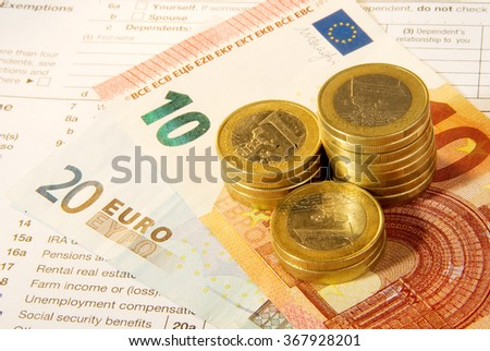 Tax form business financial concept - individual return tax form with money - stock photo