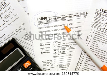tax form currency with dollar and calculator