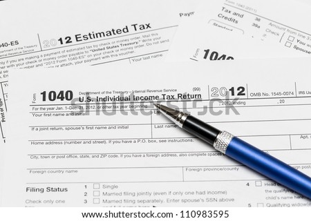 Tax form 1040 for tax year 2012 for US individual tax return with pen - stock photo