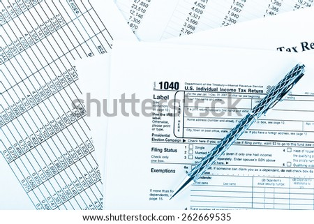 Tax form 1040  for US individual tax return with pen - stock photo