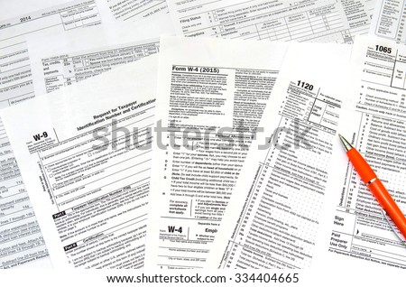 Tax form  individual tax return with pen - stock photo