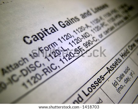 TAX Form - IRS Capital Gains or Losses - stock photo