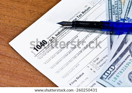 Tax form 1040 on a table, shallow depth of field - stock photo