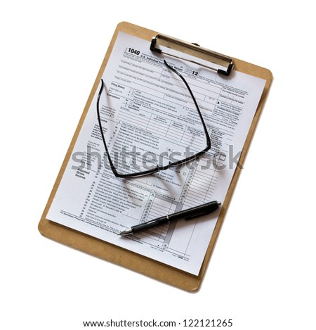 tax form on clipboard - stock photo