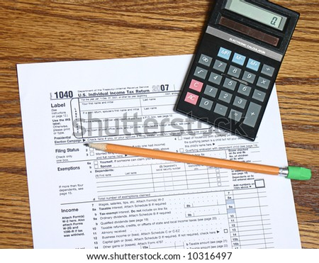 Tax form pencil and calculator for tax time