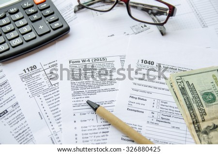 Tax Form W4, 1120, 1040 - stock photo
