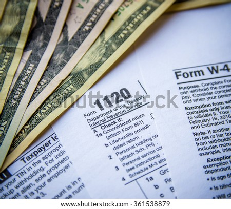 Tax Form W4, 1120, 1040. toned image - stock photo