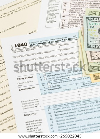 Tax form with banknote taxation concept - stock photo