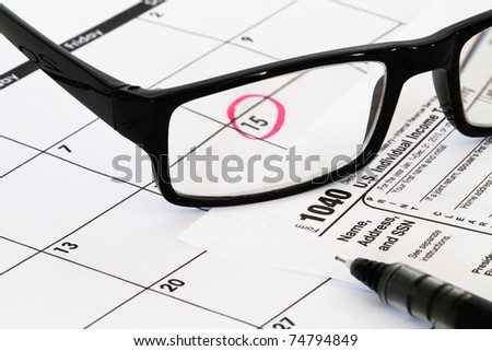 tax form with calendar and due date - stock photo