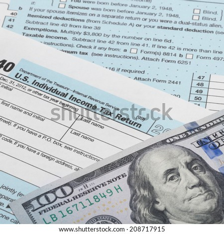 Tax Form 1040 with 100 dollars banknote - 1 to 1 ratio