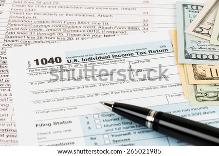 Tax form with pen, and banknote taxation concept