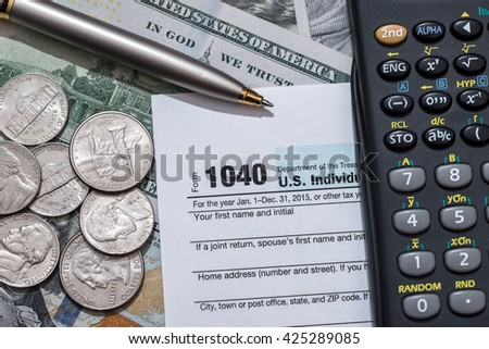 tax form with us dollar bills and coin, calculator and pen - stock photo