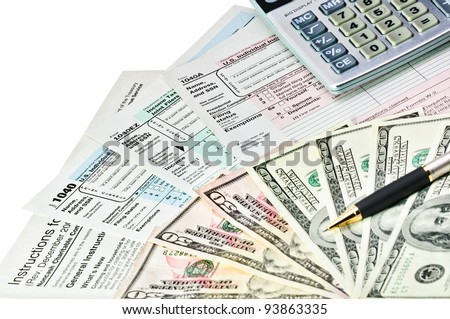 Tax forms 1040 with pen, calculator and money. - stock photo