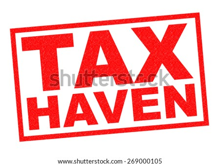 TAX HAVEN red Rubber Stamp over a white background. - stock photo