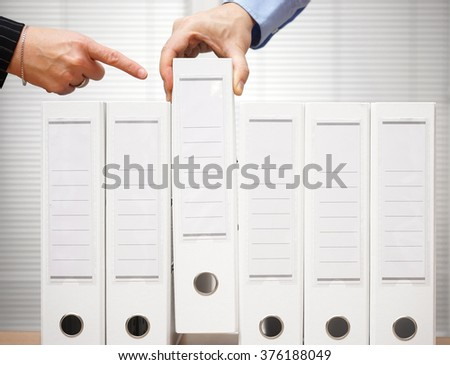 tax inspector is pointing to documentation to inspect - stock photo