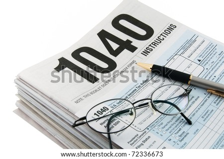 Tax instructions and tax form for tax returns preparation - stock photo