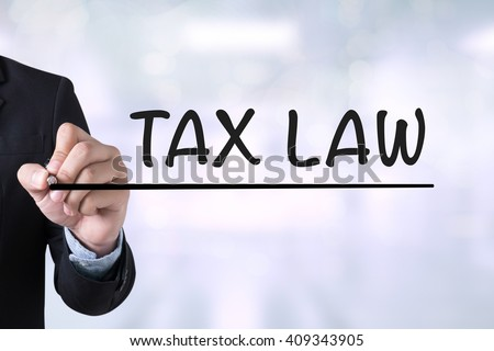 Tax Law Business Concept Businessman drawing Landing Page on blurred abstract background - stock photo