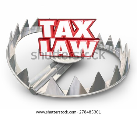 Tax Law words in red 3d letters on a bear trap illustrating legal trouble if you don't follow rules, regulations, guidelines or compliance standards in filing and paying taxes - stock photo