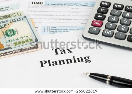 Tax planning with calculator and dollar banknote taxation concept