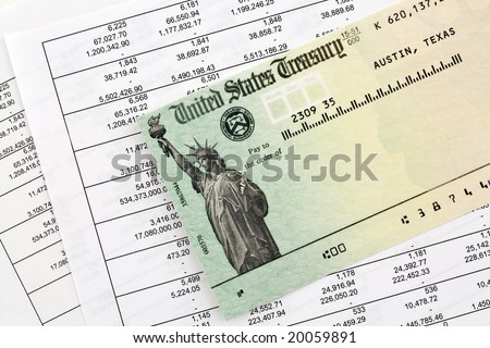 Tax refund check on top of Financial Statements - stock photo
