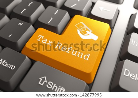 Tax Refund - Orange Button on Computer Keyboard. Internet Concept. - stock photo