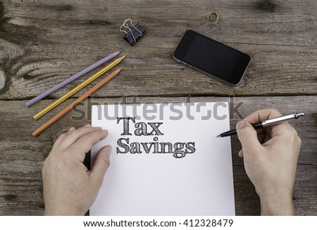 Tax Savings. Text on a sheet of paper.  - stock photo