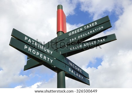 Tax Shift Signpost against cloudy sky, English words - clipping path for isolated the panels - stock photo