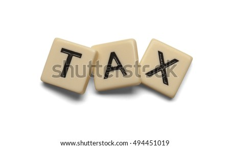 Tax spelt out with lettered tiles on white background. Clipping path included.