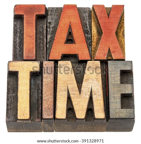 tax time banner - isolated text in vintage letterpress wood type printing block stained by color inks - stock photo