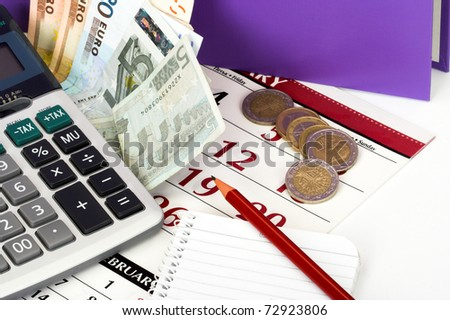 Tax time concept. Calculator and euro bill close up - stock photo