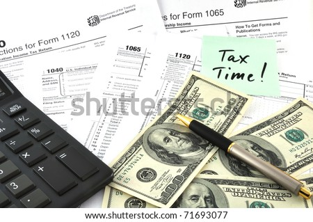 Tax Time. Concept Image with calculator, money and tax return forms as a background - stock photo