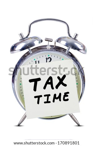 Tax time concept with alarm clock and sticky note - stock photo