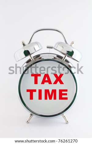 tax time on the alarm clock face. isolated on white - stock photo