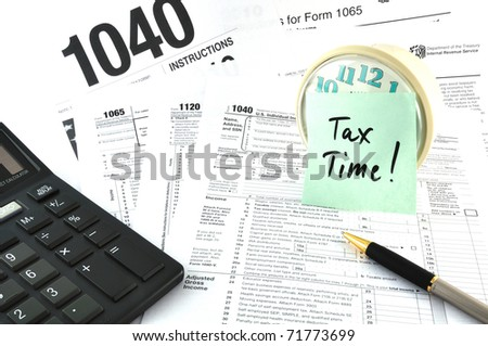 Tax Time. The Concept Image with a calculator and  a clock. - stock photo