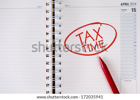 Tax time written in red into an agenda - stock photo
