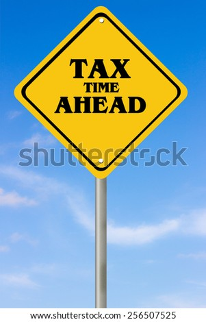 Tax timeconcept with sign post under blue sky - stock photo